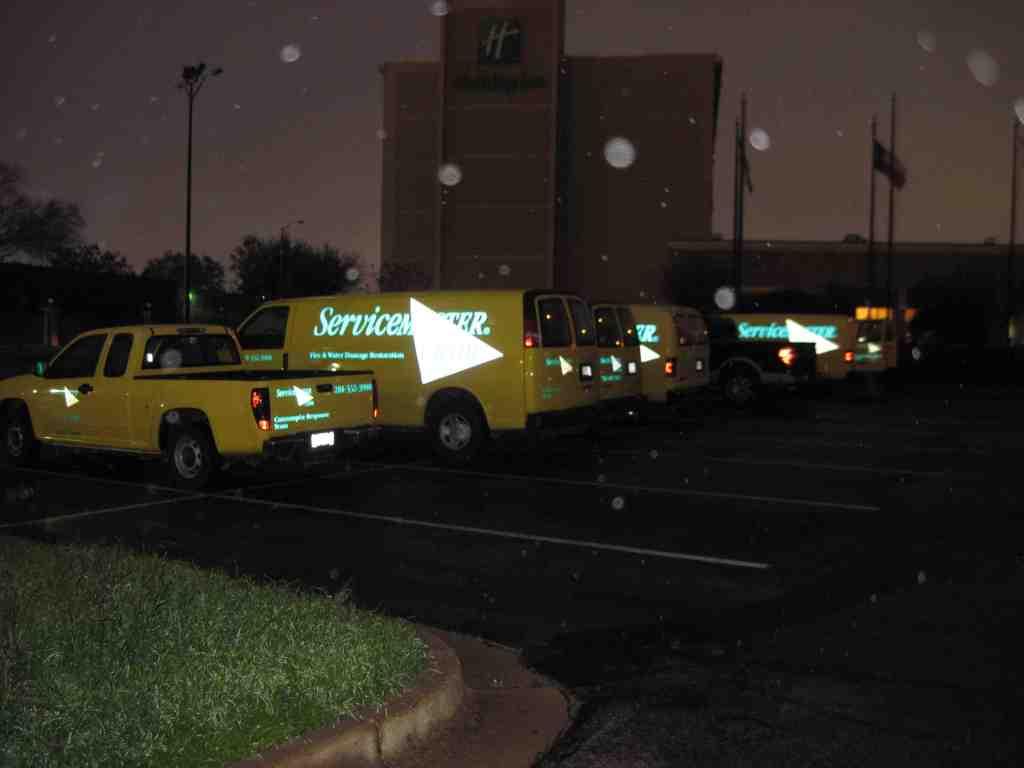 SeviceMaster Advantage Trucks Outside A Holiday Inn in Pasadena, TX