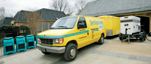 A ServiceMaster branded truck next to sewer damage restoration equipment